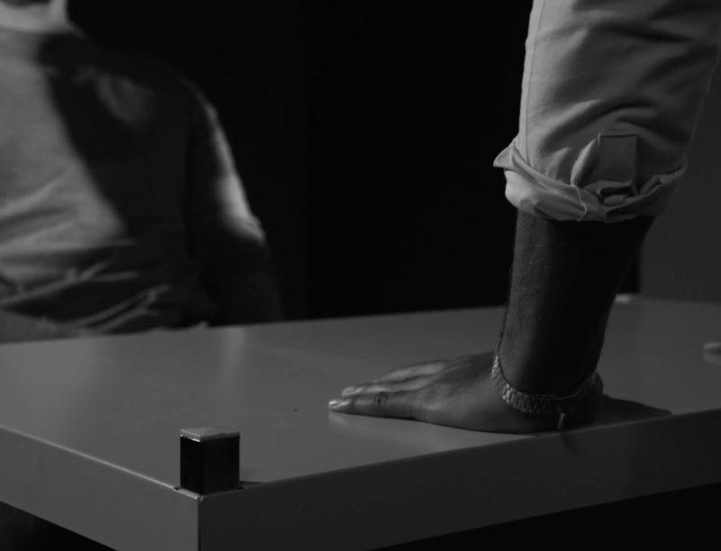 interrogator slamming their hands on a desk