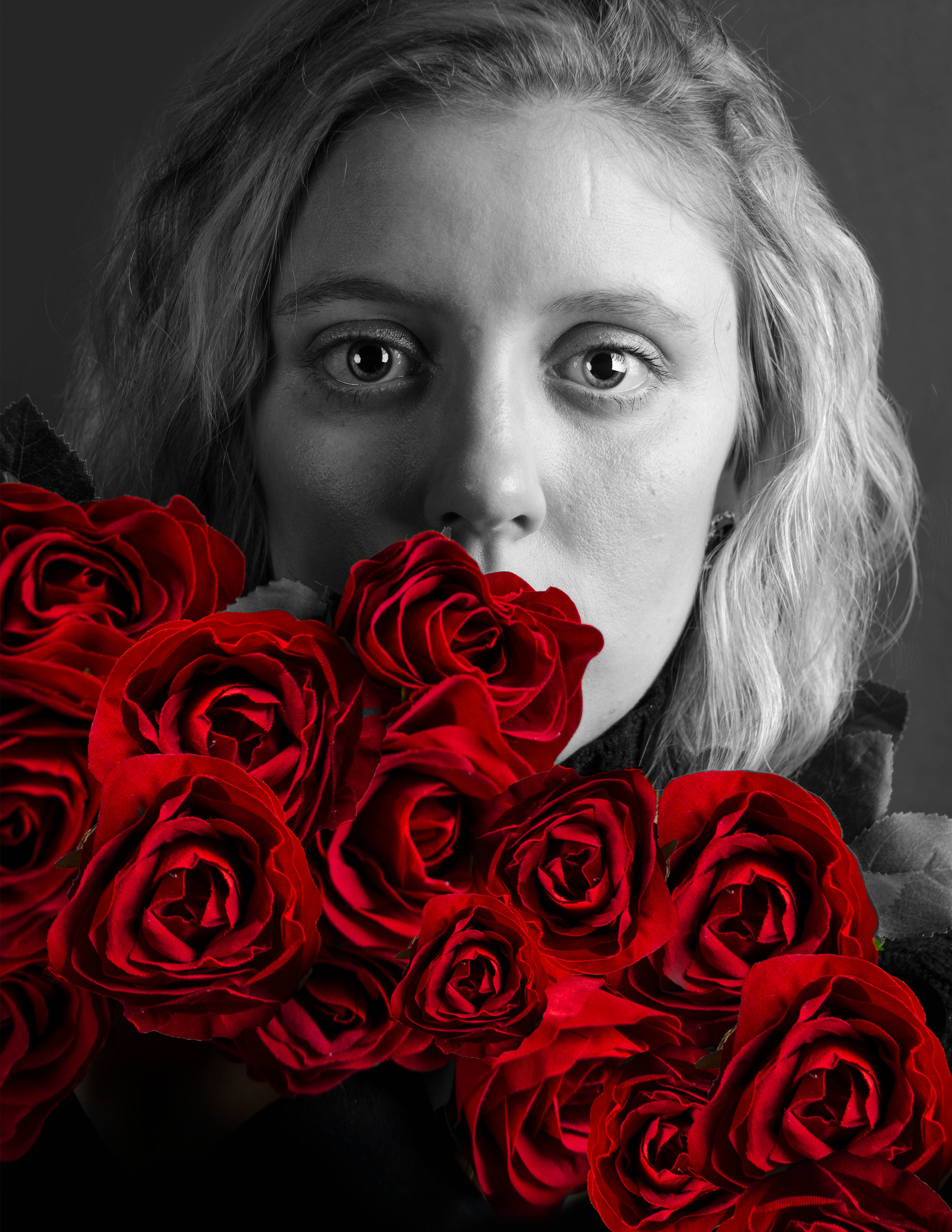 black and white portrait of women holding red roses