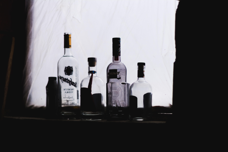 alcohol bottles on window sill