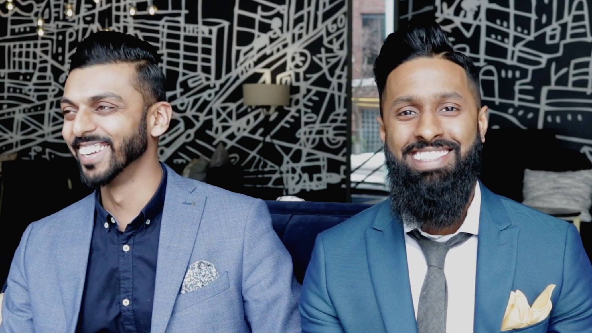 two men in blue suits smiling