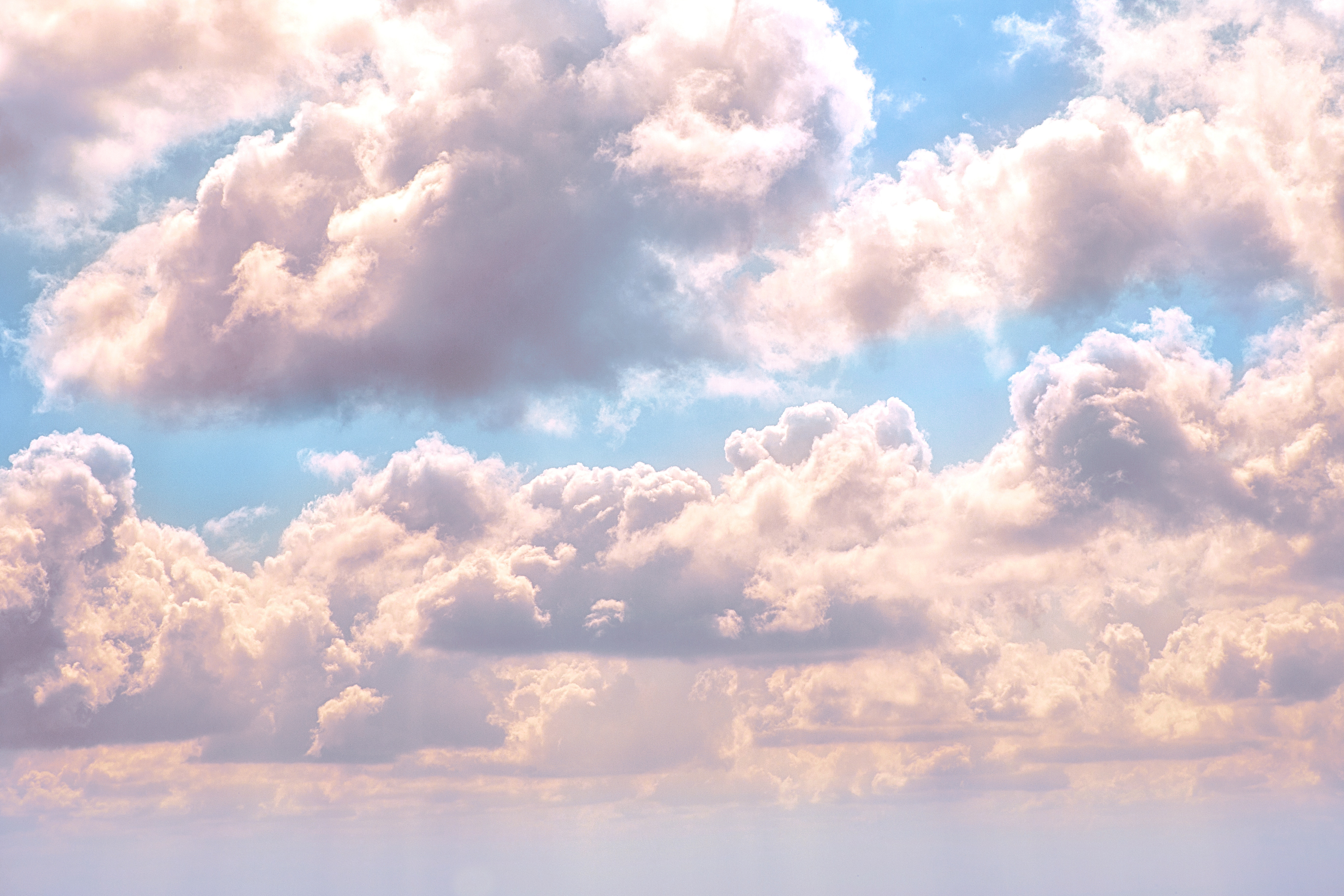 white fluffy clouds on blue sky